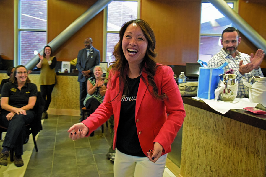 Former Contra Costa College Vice President Tammeil Gilkerson smiles as staff, faculty and students clap for her during her farewell reception in Aqua Terra Grill on Thursday.