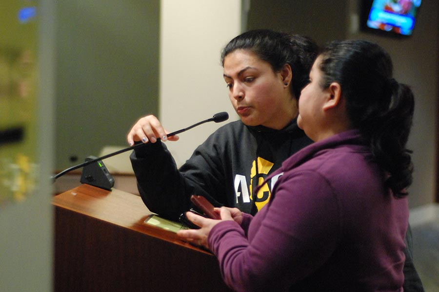 denis perez / The Advocate Community organizer Edith Pestrano translates for pro-rent control speakers during the Richmond Council meeting in Richmond, Calif. on March 7.