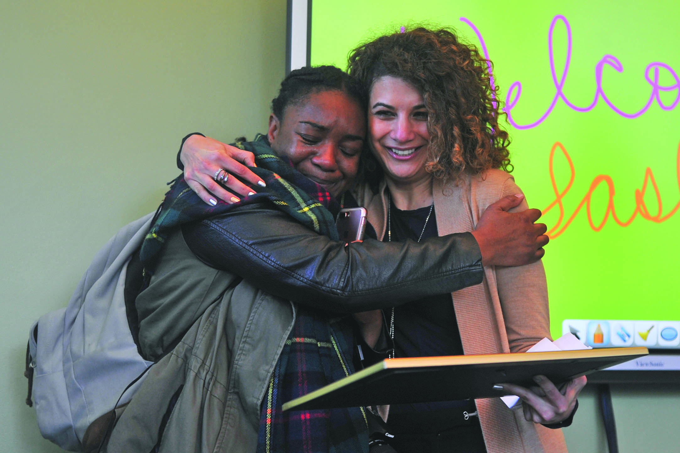 Denis Perez / The Advocate Liberal arts, social and behavioral sciences major Sasha Graham (left) hugs college President Mojdeh Mehdizadeh as she reacts to the news of winning the $40,000 per year Jack Kent Cooke Foundation Undergraduate Transfer Scholarship during a reception in the Student and Administration Building on April 18.
