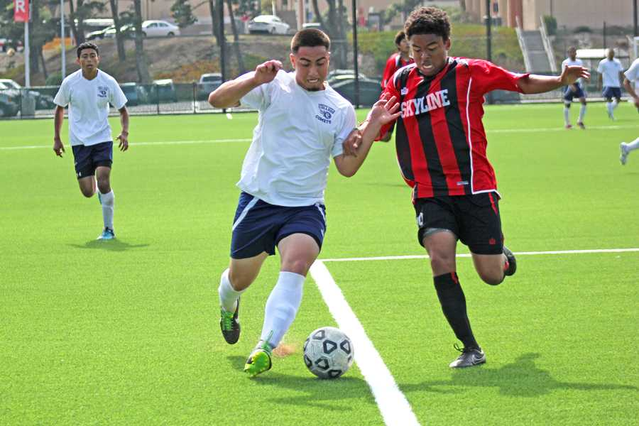 Comet forward Bryan Santos (left) battles to keep possession of the ball against Trojan defender Willem Simpson (left) during the first half of CCC's 2-1 win over Skyline College in San Bruno on Friday.