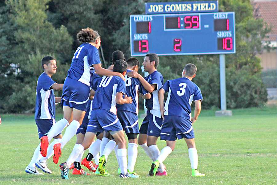 The+Comets+men%27s+soccer+team+celebrates+their+last+minute+goal+during+CCC%27s+1-1+draw+against+American+River+College+at+the+Soccer+Field+on+Sept.+16.