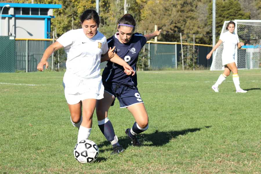 Comet defender Marielena Salazar battles for the ball during CCC's 4-0 loss to Hartnell College at the Soccer Field on Sept. 15.