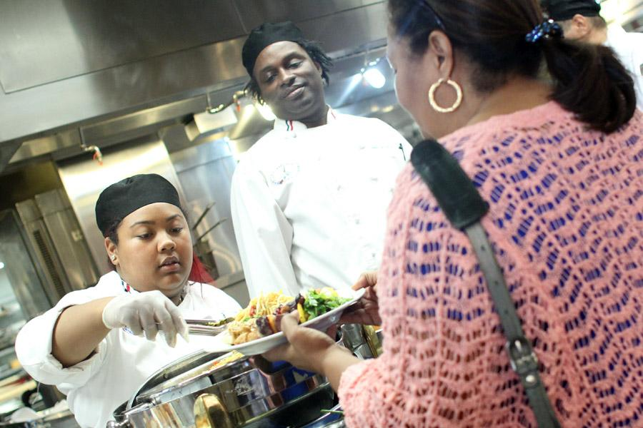 Culinary arts major Tatiana Abrea (left) serves a dish to Brenda Pless, a senior library assistant (right), during the Iron Chef Competition in the Three Seasons Restaurant on Aug. 28.