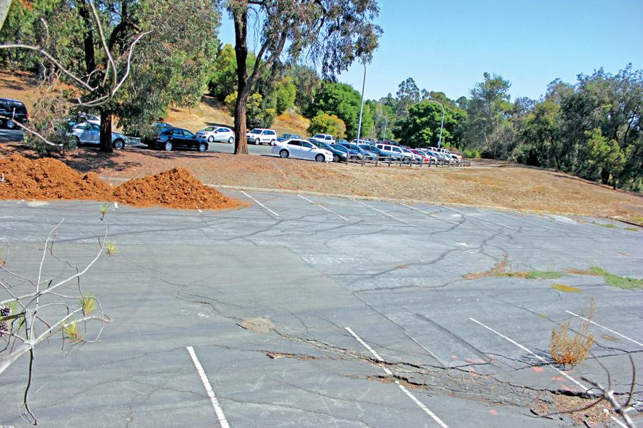 The student-dedicated parking Lot 16 has space to accomodate 41 vehicles, but has gone unused by the college for two years due to a sinkhole in the middle of the lot. Pending the approval of the district Governing Board, Lot 16 may be repaired and re-opened as early as spring 2015.