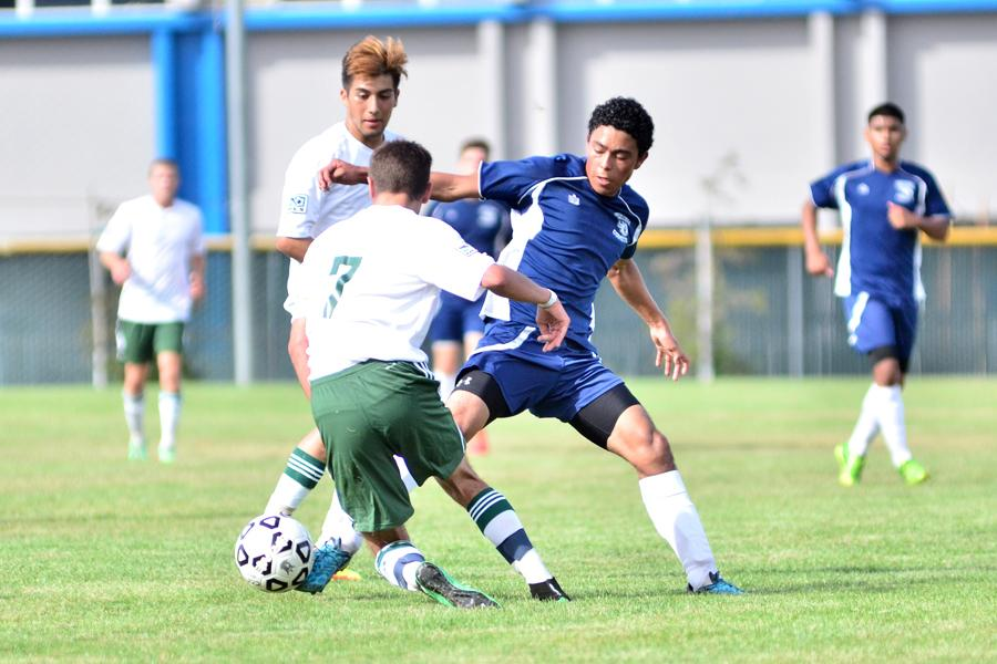Comet midfielder Missael Hernandez (middle) successfully commits a tackle against Knights defenders Gabe Chimenti (back) and Juan Serrano (7) during the first half of CCC's 2-0 win over Modesto Junior College on the Soccer Field on Aug. 29.