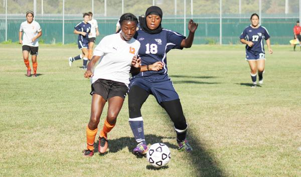 Lassen midfielder Jordain Shedrick (left) challenged defender Taheerah Brewes (right) for possession of the ball during CCC's loss to Lassen College at the Soccer Field on Sept. 5.