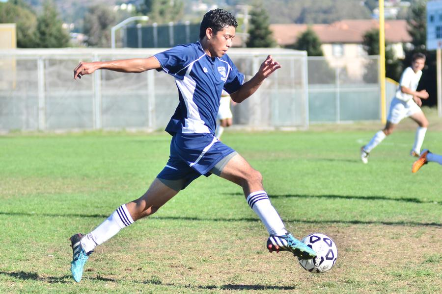 Comet winger Missael Hernandez strides down field with the ball during CCC's 3-0 win against Folsom Lake College at the Soccer Field on Friday. Hernandez used his quick pace to create attacking options for the Comets.