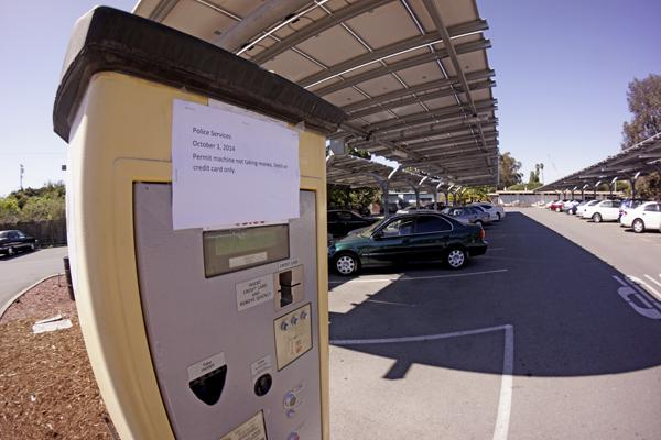 A temporary parking permit dispenser in Lot 10 has been unable to accept cash. Since Oct. 1, only credit or debit cards have been accepted.