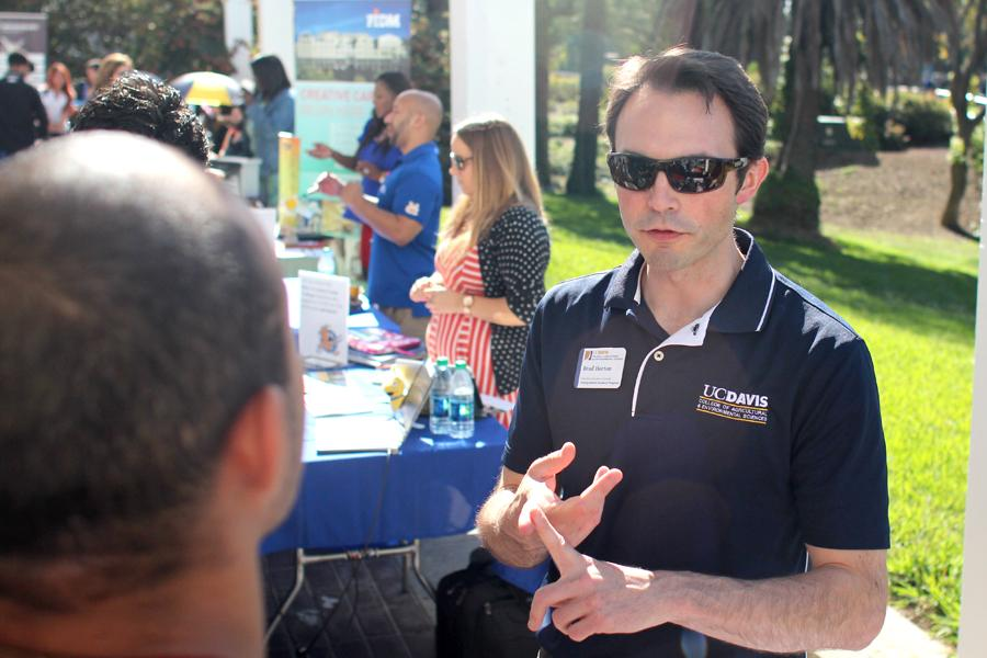 Brad Horton, a UC Davis international academic counselor, lists the steps for transfer to engineering major Christian Talavera during the annual Transfer Day held in front of the Liberal Arts Building on Oct. 7.