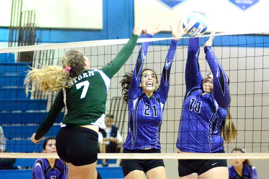 Comet+players+Valeria+Avila+%28center%29+and+Kailey+Walker+attempt+to+block+a+ball+hit+by+Storm+middleblocker++Katie+Morris+during+CCC%E2%80%99s+loss+to+Napa+Valley+College+in+the+Gymnasium+on+Friday.
