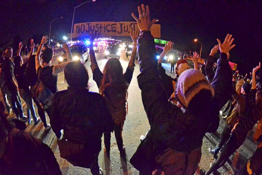 Protesters stand their ground on the i-580 highway during a protest in Oakland, Calif., on Tuesday, Nov. 25, 2014. a day after a Missouri grand jury decided not to indict white police officer Darren Wilson in the fatal shooting of black teenager Michael Brown in Ferguson, Mo.