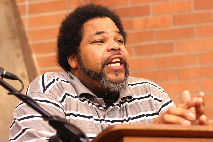 """Poet Steven Clark, also known as HurriKane da Poet, informs audience members in the Library and Learning Resource Center about his book, """"Poetry for the People,"""" on Feb. 18."""