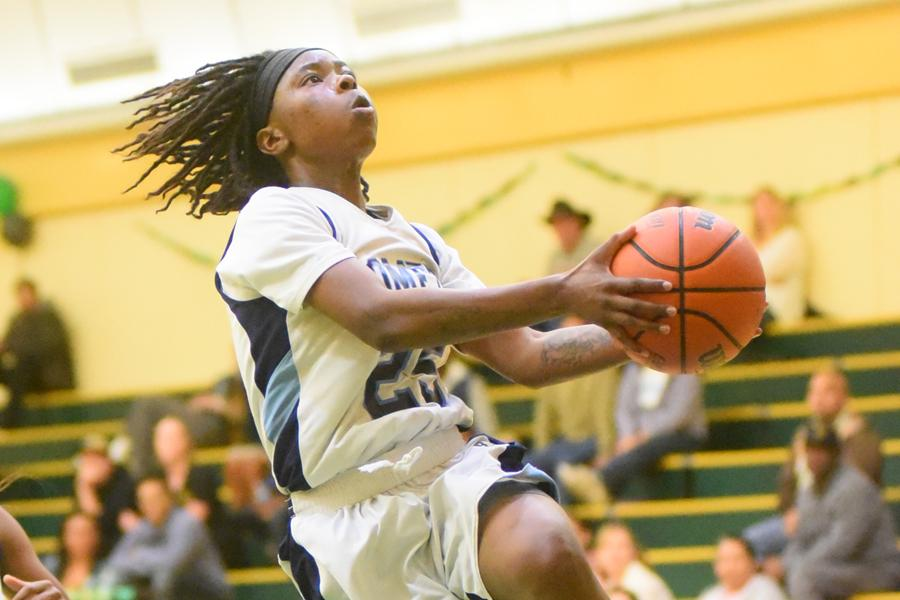 Comet guard Ahjahna Coleman  leaps for a lay up during CCC's 66-56 loss to the Storm at Napa Valley College on Friday.