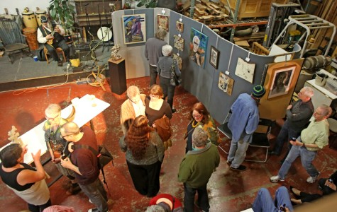 Community members and artists mingle during the second ever Berkeley Art Party in the DaSilva Ukulele Co., Suite 28, of the historic Sawtooth Building on Eighth Street, Friday night.