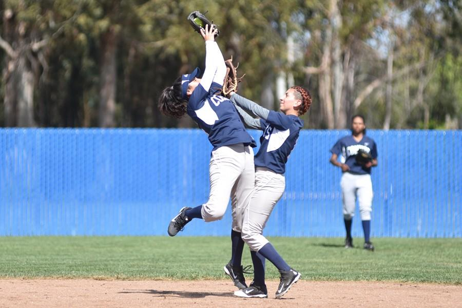 Comet softball players Angelica Espinal (left) and Melissa Watkins collide after a successful catch during CCC's 17-4 loss to the Falcons at Solano Community College on Thursday.
