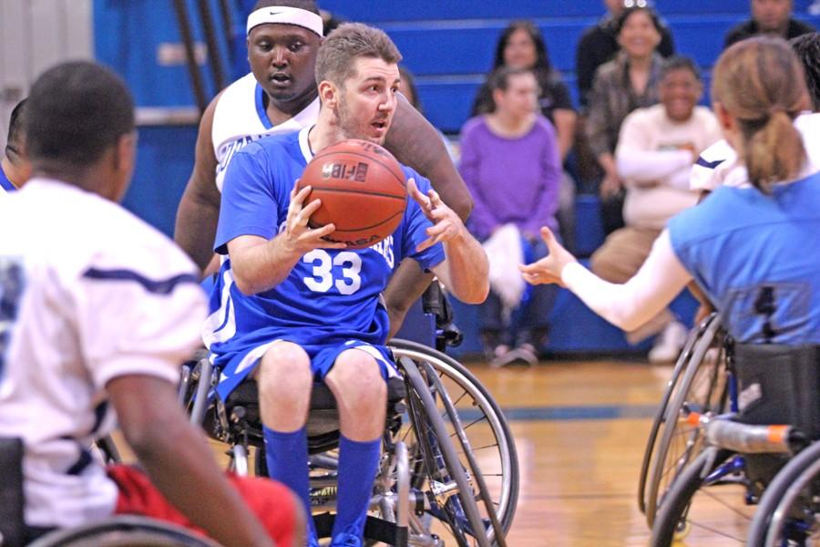 Bay+Area+Outreach+and+Recreation+Program+All+Star+team+member+and+Vallejo+resident+Troy+Plunkett+looks+to+pass+the+ball+during+the+wheelchair+basketball+match+in+the+Gymnasium+on+March+19.