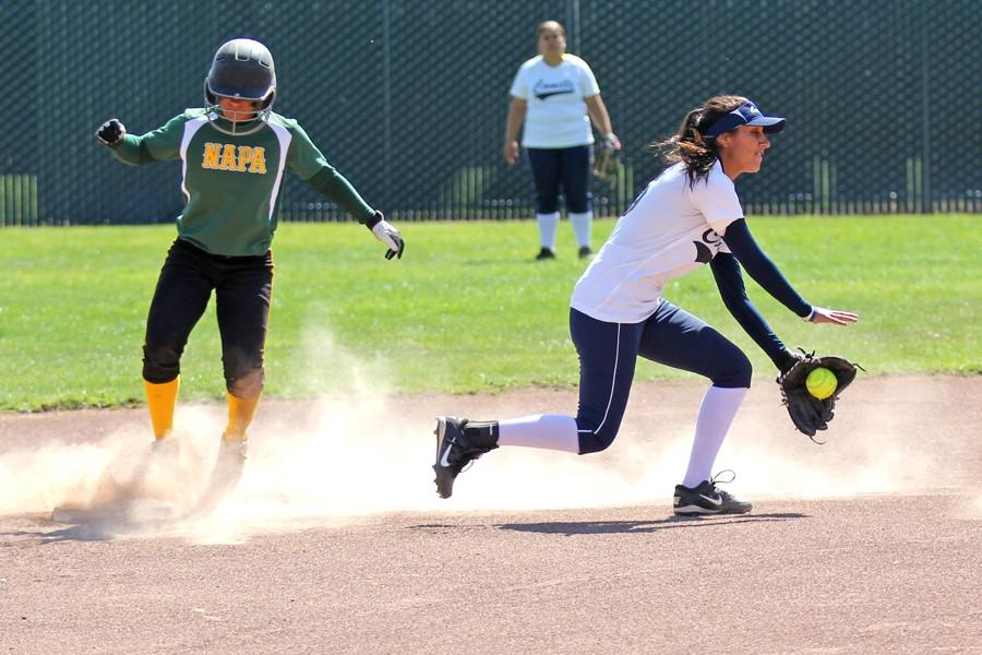 Comets' shortstop Angelica Espinol (right) fails to make an out during CCC's loss to Napa Valley College at the Softball Field on Thursday. The Comets ended their season with a doubleheader loss to the Storm, 20-0 and 15-0.