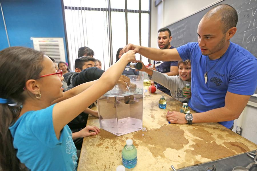 ABOVE: Society of Hispanic Professional Engineers Vice President Christian Talavera educates K-12 students during the STEM Day in the PS-113 on March 21.
