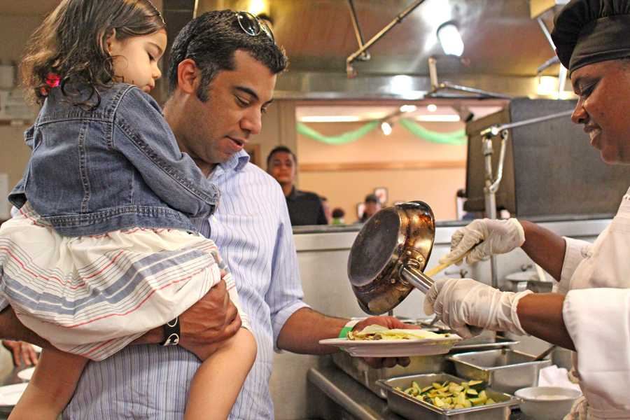 San Pablo resident Jose Castellanos and daugther Malena are served a breakfast omelet during the Chef and Child event co-hosted by the early childhood education and culinary departments in the Three Seasons Restaurant on Saturday.