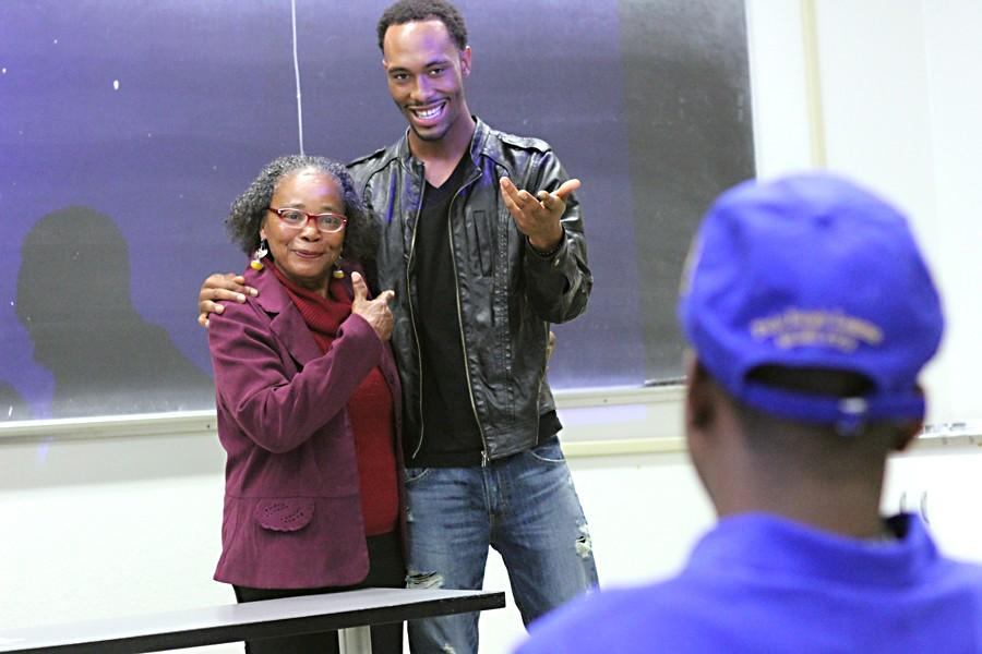 Social science adjunct professor Majeedah Rahman (left) and psychology major Armani Ward introduce the next presenter for a class exercise featuring music during the Contemporary Men class in LA-201 on May 6.