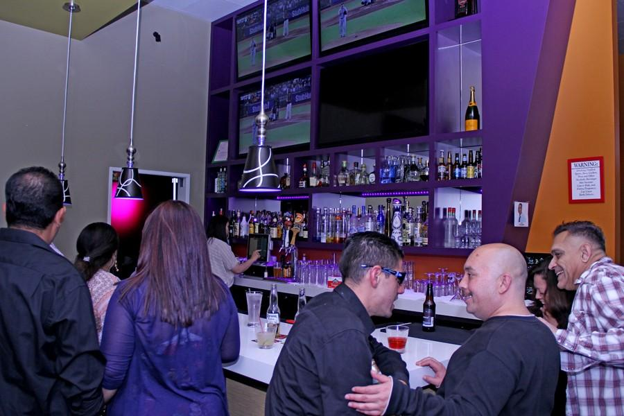 People congregate around the bar inside of Noya Lounge & Bar in San Pablo on Saturday. The restaurant is now offering up to four $500 scholarships to Contra Costa College students.