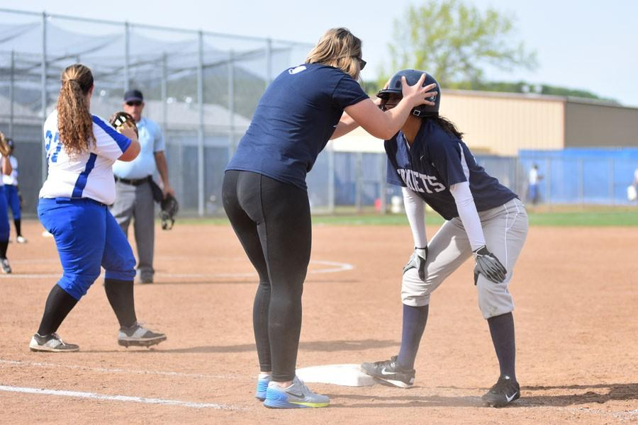 Comet assistant coach Claire Scott hypes up shortstop Angelica Espinal after she was safe at first base during CCC's 17-4 loss to the Falcons at Solano Community College on March 12.