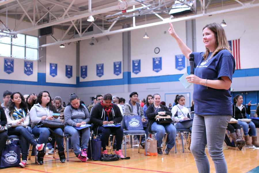 Counselor Sarah Boland explains the steps needed to enroll at Contra Costa College to incoming freshmen from surrounding high schools during the Super Saturday event in the Gymnasium on Saturday.