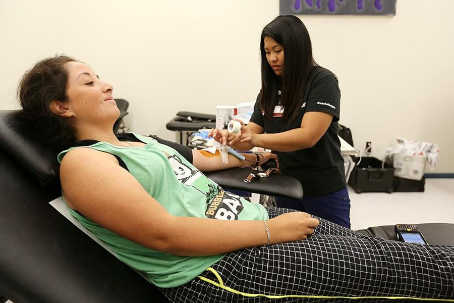 Communications major Perla Juarez gets her blood drawn by an American Red Cross assistant in the Recreation Room during the Red Cross Blood Drive on Sept. 23.