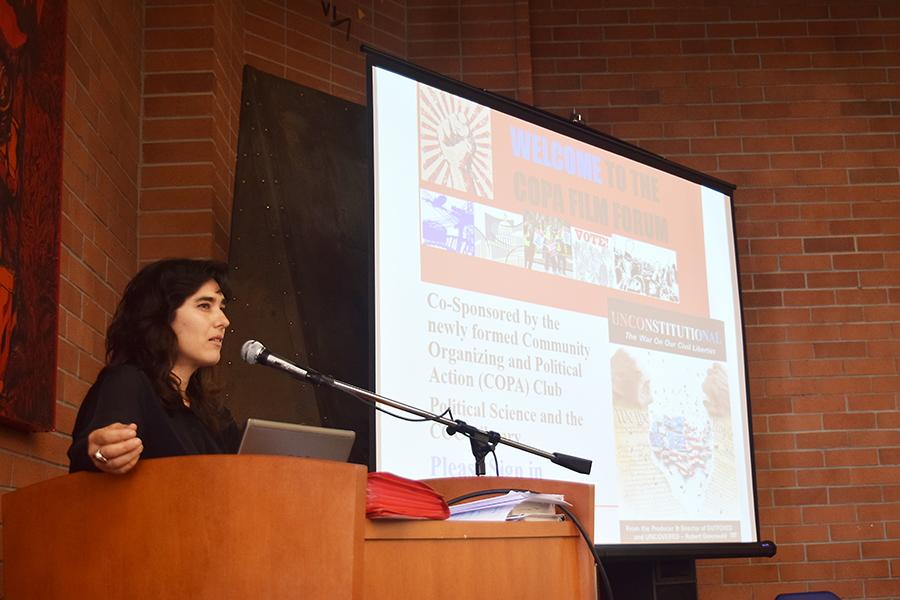 "Political science  professor Vanna Gonzales introduces the ""Unconstitutional"" documentary during the Community Organizing and Political Action Club (COPA) film forum in the Library on Thursday."