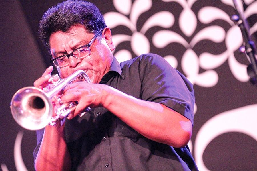 Los Compas Pachanga band leader Miguel Govea sounds off a rendition of one of the group's more famous tunes at the Los Cenzontles Cultural Academy in Richmond on Saturday.
