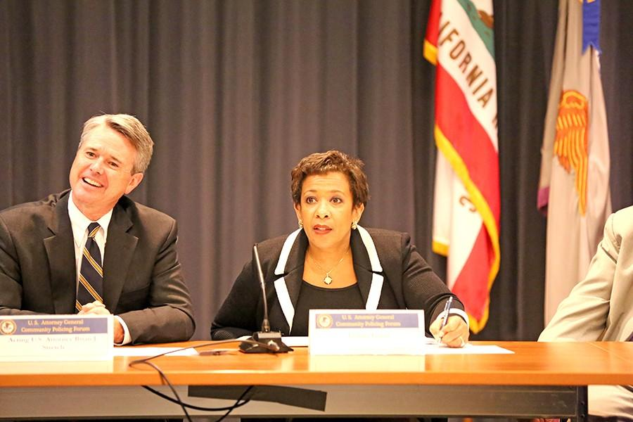 U.S. Attorney for the Northern District of California Brian Stretch and U.S. Attorney General Loretta Lynch listen to community members during her visit on Friday at the Civic Center Auditorium.
