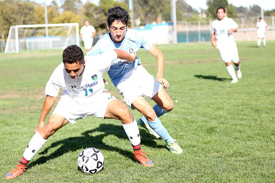 Coyote midfielder Daniel Valdez (left) shields Comet striker Bryan Vega (right) from the ball during Contra Costa College's 3-1 loss to Lake Tahoe Community College on Friday at the Soccer Field.