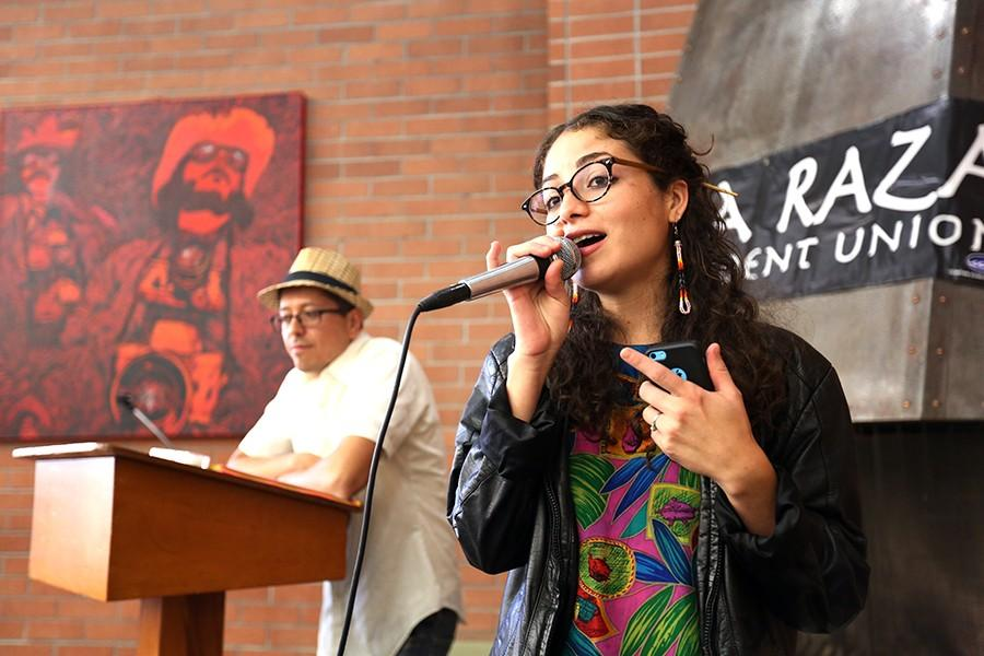 Local rapper and teacher Chhoti Maa (right) concludes her poetry set during Indigenous People's Day in Diaspora in the Library on Monday. Maa's performance included raps and a cappella songs concerning decolonization and Columbus Day.