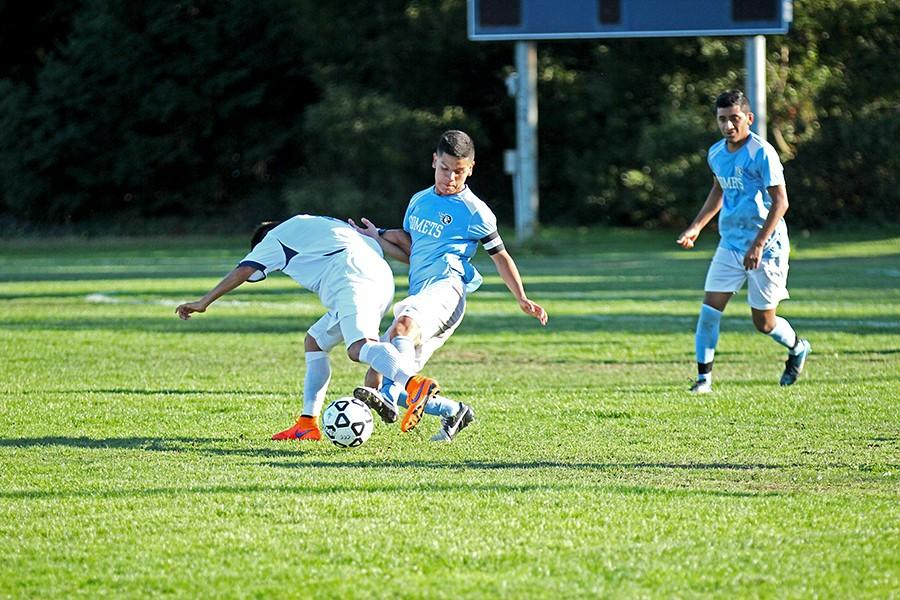 Comet defender Jesus Villagrana (right) fights for possession of the ball against Bear Cub midfielder Jovani Carolino during Contra Costa College's 2-0 loss to Santa Rosa Junior College at the Soccer Field on Friday.