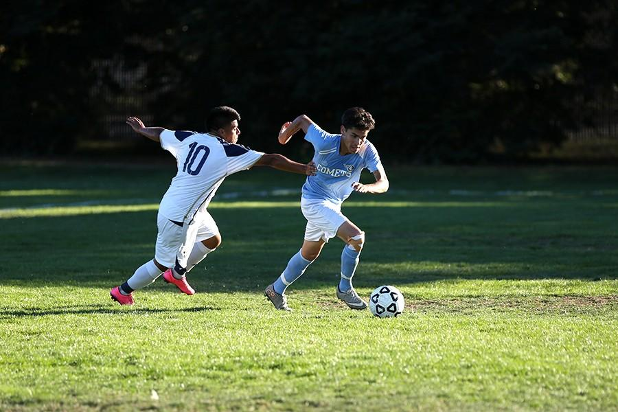 Comet center back Edgar Yepes steals the ball from Eagle midfielder Oscar Martinez during the Comets' 2-1 win at the Soccer Field on Friday. The Comets host Santa Rosa Junior College today at 4 p.m.