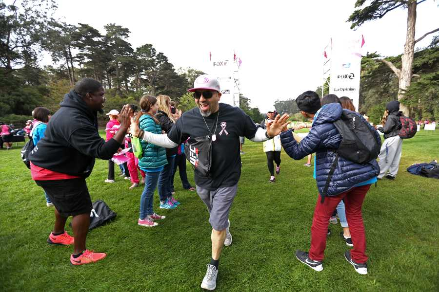 Santa Clara resident Jimmy Ramirez completes his eighth walk during the Making Strides for Breast Cancer Walk at Golden Gate Park in San Francisco on Saturday.