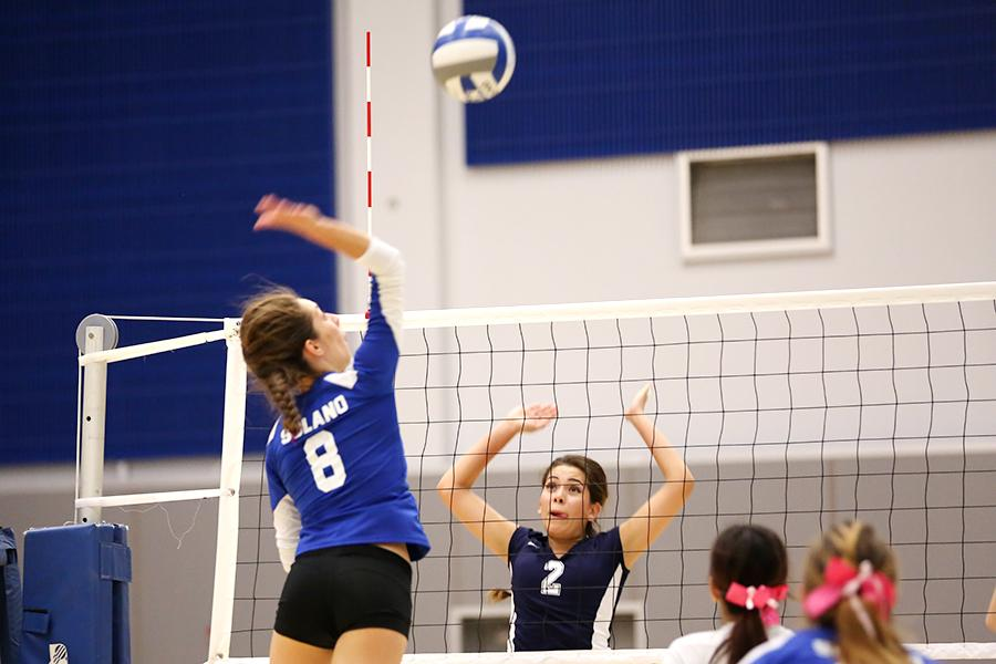 Falcon outside hitter Claudia Diaz strikes the ball to Comet setter Paula Sanchez during Contra Costa College's three-set loss at Solano Community College on Friday.