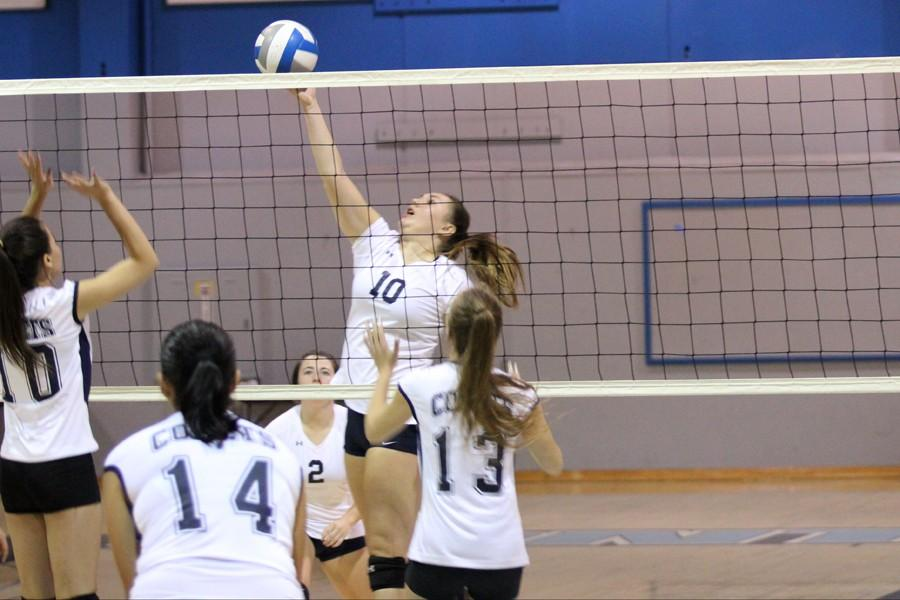 Eagle+outside+hitter+Jamie+Mertle+tips+the+ball+over+the+net+and+Comet+middle+blocker+Mariah+Marinho+%28left%29+during+the+game+against+Mendocino+College+on+Friday+in+the+Gymnasium.+