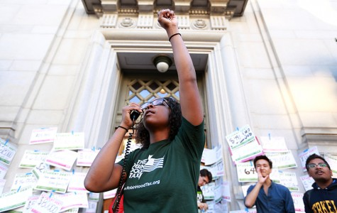 Lauren Butler, a Million Student March organizer and UC Berkeley senior rallies other protesters to chant with her during the Million Student March at California Hall at UC Berkeley on Thursday, Nov. 12, 2015. The protest called for tuition-free education, creation of a $15 per hour minimum wage for jobs campuswide and the remission of any existing student debt.
