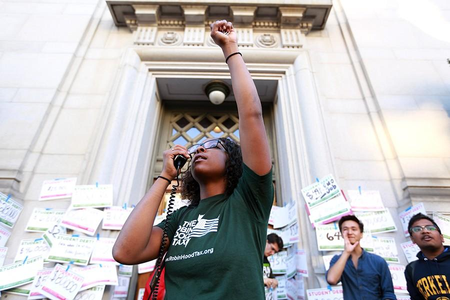 Lauren+Butler%2C+a+Million+Student+March+organizer+and+UC+Berkeley+senior+rallies+other+protesters+to+chant+with+her+during+the+Million+Student+March+at+California+Hall+at+UC+Berkeley+on+Thursday%2C+Nov.+12%2C+2015.+The+protest+called+for+tuition-free+education%2C+creation+of+a+%2415+per+hour+minimum+wage+for+jobs+campuswide+and+the+remission+of+any+existing+student+debt.