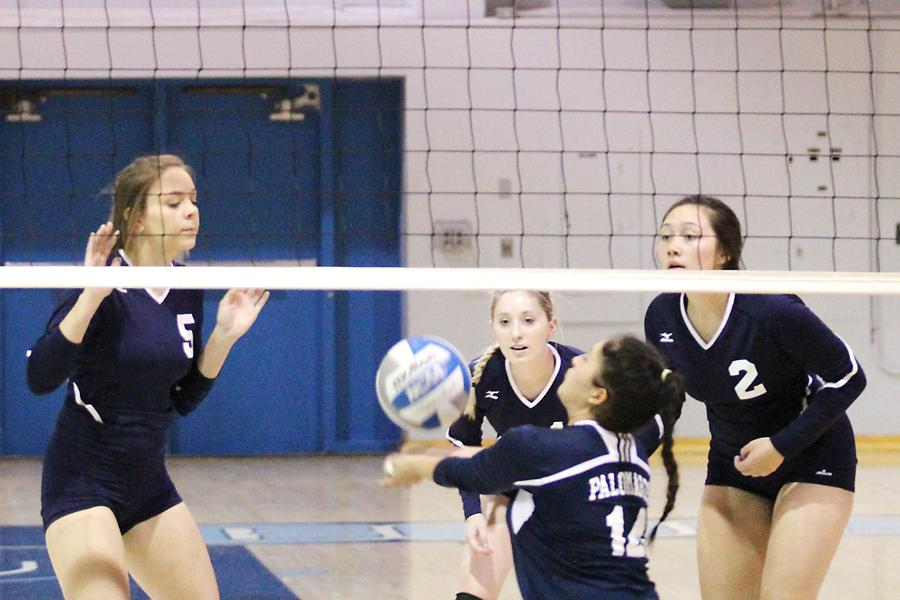 Right setter Amy Palomares (center) fails to dig against a 49er drop shot during the Comets' loss to Yuba College in the Gymnasium on Friday.