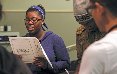 Music major Savannah Cofield-Bey (left) rehearses with the Jazzanova performance group on Monday in M-116.