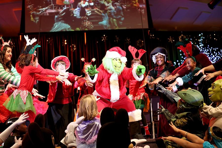 """Adults and children surround the Grinch during the """"Night of Hope"""" concert  at Valley Bible Church in Hercules on Sunday."""