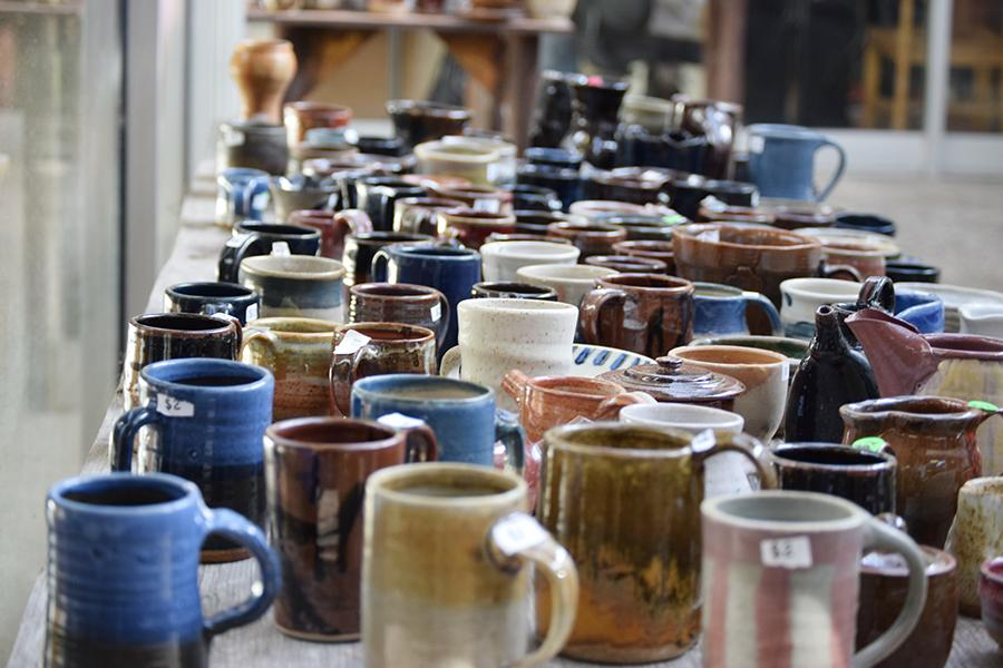 Dozens of pottery items lay in wait for customers during the week long pottery sale in the Art Building Atrium.