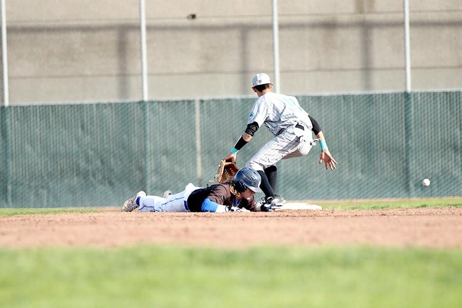 Comet first baseman Chris Brue slides back to second base and is able to make it to third when Mission second baseman Adam Rios was unable to field the ball.
