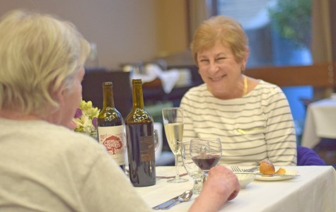 Pinole resident Carol Jenning (right) enjoys conversation with a friend during the 2nd Annual Cupid's Season Dinner in the Three Seasons Restaurant on Feb. 11.