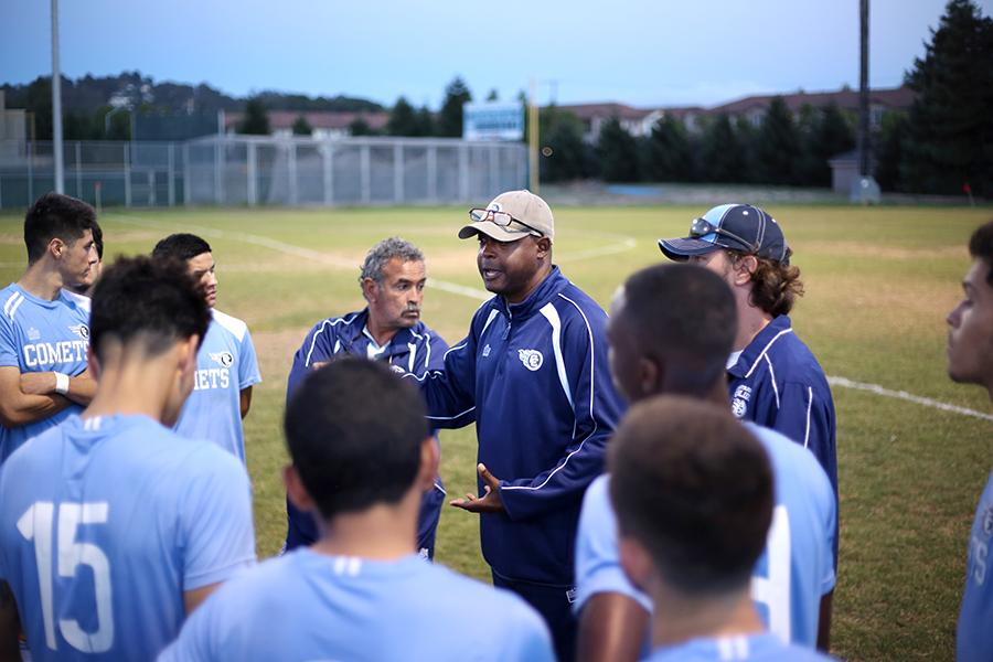 Comet coach Nikki Ferguson gives his squad an impassioned speech before taking the field under the lights at the Soccer Field. Ferguson was Bay Valley Conference coach of the year.