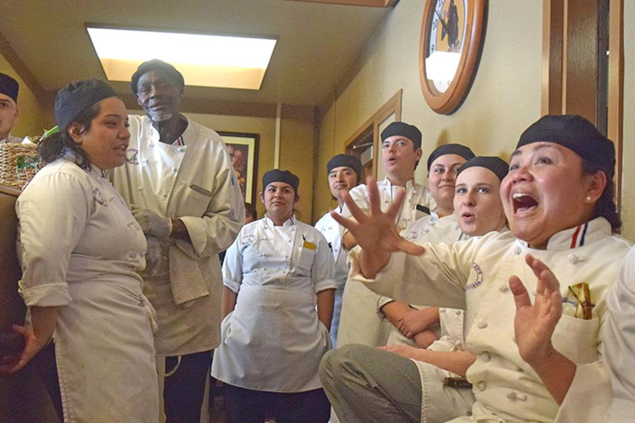 Culinary arts major Jocelyn Samson (right) jumps after hearing her team had won first place during the Iron Chef competition in the Three Seasons Restaurant on Wednesday.