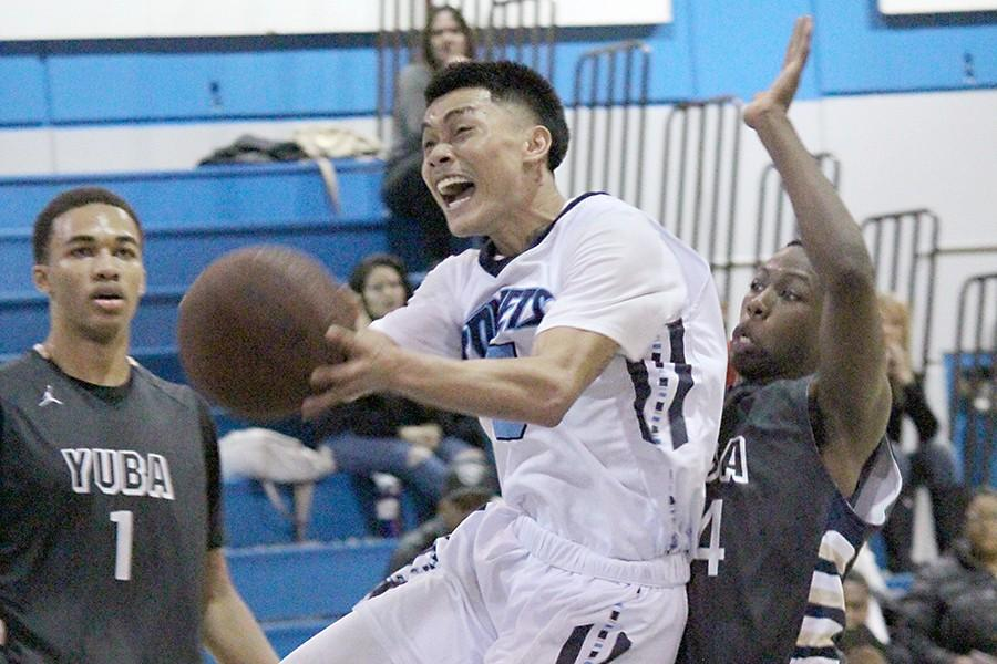 Point guard Bobby Syvanthong powers his way through the Yuba College defense during the Comets' Bay Valley Conference tournament loss on Feb. 17. Syvanthong was fouled immediately after the attempted lay-up.