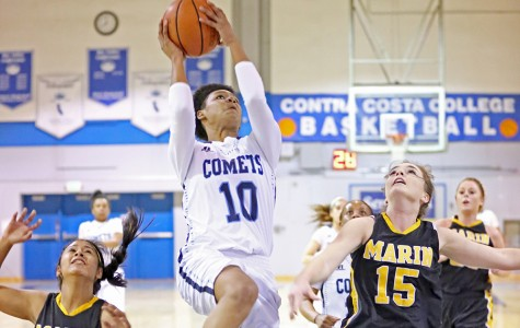 Comet guard Jacqie Moody goes up for a layup against Mariners guard Janelle Pansoy and foward Christiana Onwuasoeze during Contra Costa Colleges 80-57 win against College of Marin in the Gymnasium on Friday.